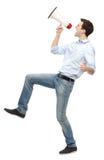 Uomo che grida tramite il megafono Fotografia Stock