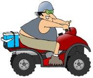 Uomo che guida un ATV Immagini Stock