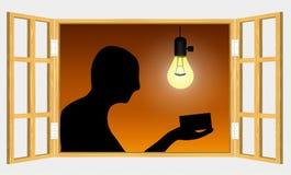 Uomo che ispeziona qualcosa nell'ambito della luce Fotografia Stock Libera da Diritti