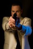 Uomo che mira pistola voi Fotografia Stock Libera da Diritti