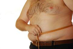 Uomo che misura la sua pancia Fotografia Stock Libera da Diritti