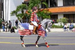 Uomo che monta un cavallo Fotografie Stock Libere da Diritti