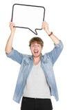 Uomo che mostra la bolla di discorso del segno Fotografie Stock Libere da Diritti