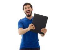 Uomo che mostra libro Immagine Stock