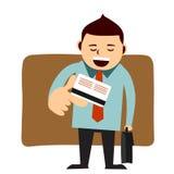 Uomo che paga con la sua carta di credito Fotografia Stock