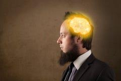uomo che pensa con l'illustrazione d'ardore del cervello Immagini Stock