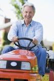 Uomo che per mezzo del trattore Immagine Stock Libera da Diritti