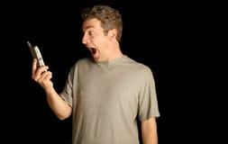Uomo che per mezzo di un telefono Fotografia Stock Libera da Diritti