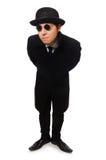 Uomo che porta cappotto nero isolato su bianco Fotografia Stock