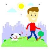 Uomo che prende il suo cucciolo per una passeggiata al parco Immagini Stock