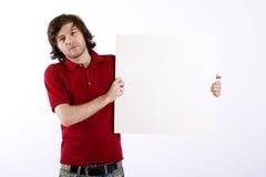 Uomo che presenta una scheda in bianco Immagini Stock Libere da Diritti