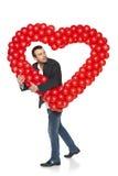 Uomo che sbircia con la forma del cuore Fotografie Stock