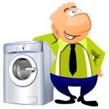Uomo che si appoggia sulla lavatrice. Fotografia Stock