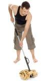 Uomo che si leva in piedi con la mano sul mop Fotografie Stock