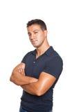 Uomo che si leva in piedi con le braccia attraversate Fotografia Stock
