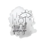 Uomo che si siede nella pioggia da solo Fotografia Stock