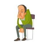 Uomo che si siede su una sedia Immagini Stock