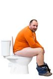 Uomo che si siede sulla toletta Fotografie Stock Libere da Diritti