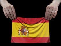 Uomo che tiene bandierina spagnola Fotografia Stock
