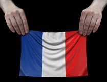 Uomo che tiene la bandiera del francese Immagine Stock Libera da Diritti