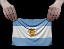 Uomo che tiene la bandiera dell'Argentina Fotografia Stock Libera da Diritti