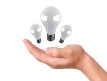 Uomo che tiene lampadina Successo nell'affare Fotografia Stock