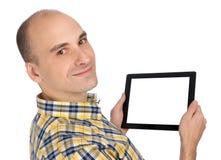 Uomo che tiene un calcolatore in bianco del ridurre in pani Fotografia Stock Libera da Diritti