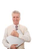 Uomo che tiene un computer portatile Fotografie Stock Libere da Diritti