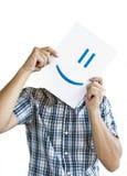 Uomo che tiene un sorriso davanti al fronte Immagini Stock