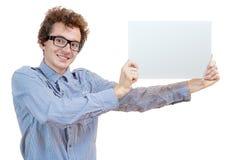 Uomo che tiene un tabellone per le affissioni in bianco Immagini Stock