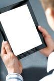 Uomo che tiene un touchpad fotografie stock