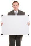 Uomo che tiene una scheda bianca. Fotografia Stock Libera da Diritti
