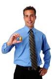 Uomo che tiene uovo dorato Immagine Stock