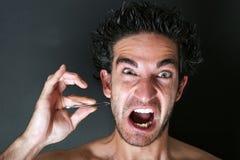 Uomo che tira la sua barba Immagini Stock Libere da Diritti