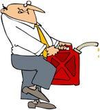 Uomo che trasporta una latta della benzina Immagine Stock