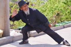 Uomo cinese anziano Kung Fu Demonstration 5 Fotografia Stock