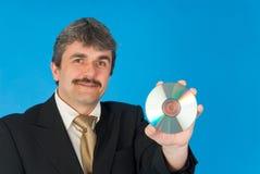 Uomo con Cd Fotografie Stock Libere da Diritti