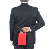 Uomo con del regalo del sacchetto la parte posteriore dietro Fotografie Stock Libere da Diritti