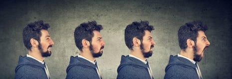 Uomo con differenti emozioni ed espressioni del fronte Fotografia Stock