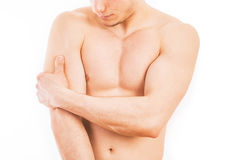 Uomo con dolore del tricipite Immagini Stock