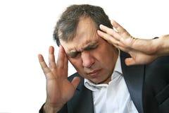 Uomo con dolore della testa di grande Fotografie Stock