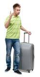 Uomo con gesturing d'argento di attenzione della valigia fotografia stock
