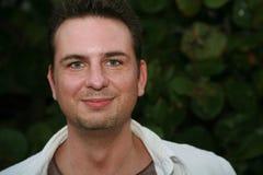 Uomo con gli occhi verde smeraldo Fotografia Stock