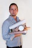 Uomo con i piani Fotografia Stock