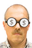 Uomo con i simboli di dollaro sui suoi vetri Fotografie Stock