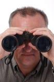Uomo con il binocolo Fotografie Stock Libere da Diritti