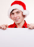 Uomo con il bordo vuoto in bianco dell'insegna Natale Fotografie Stock Libere da Diritti