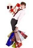 Uomo con il contenitore di regalo del gruppo ed il sacchetto di acquisto di caduta. Fotografia Stock Libera da Diritti