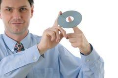 Uomo con il disco CD Fotografia Stock