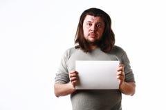 Uomo con il foglio di carta vuoto Fotografia Stock